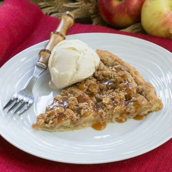 Apple Pie Pizza | A dessert pizza made with a pastry crust, spiced apples, streusel and drizzled with caramel
