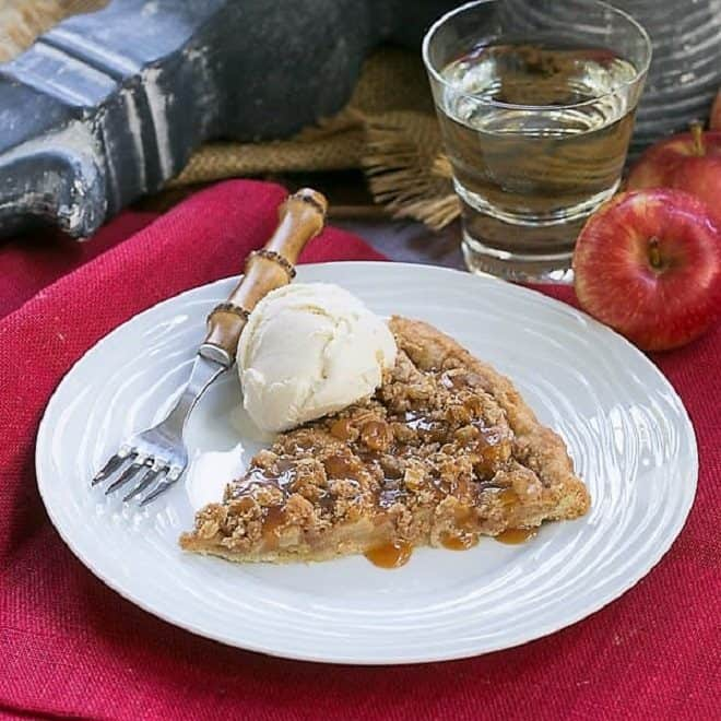 Apple Pie Pizza slice with a scoop of ice cream on a white dessert plate