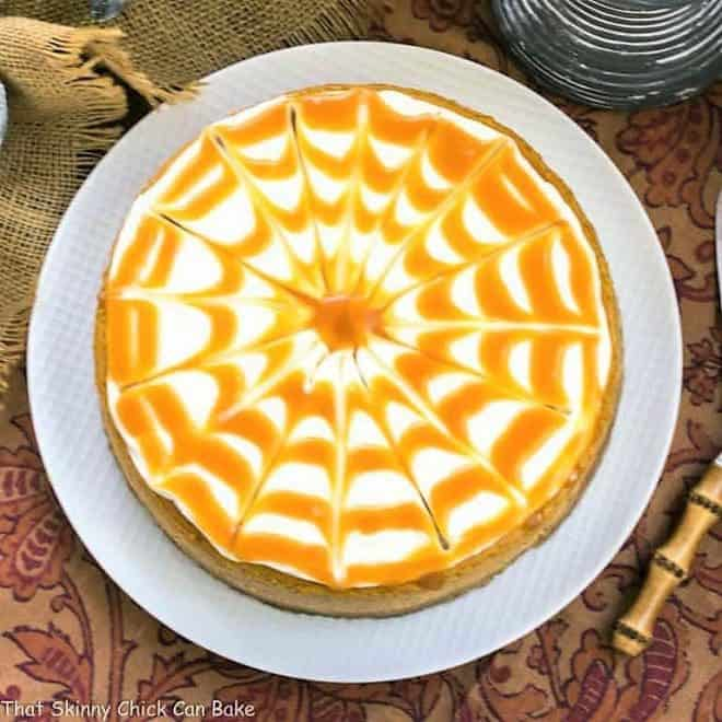 Caramel Topped Pumpkin Cheesecake from above on a white cake plate