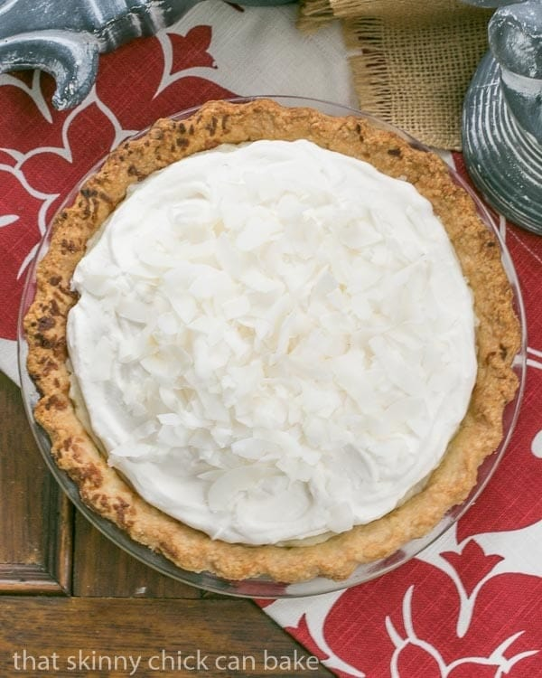 Coconut Cream Pie   Coconut crust filled with creamy coconut laden custard with a decadent whipped cream topping!