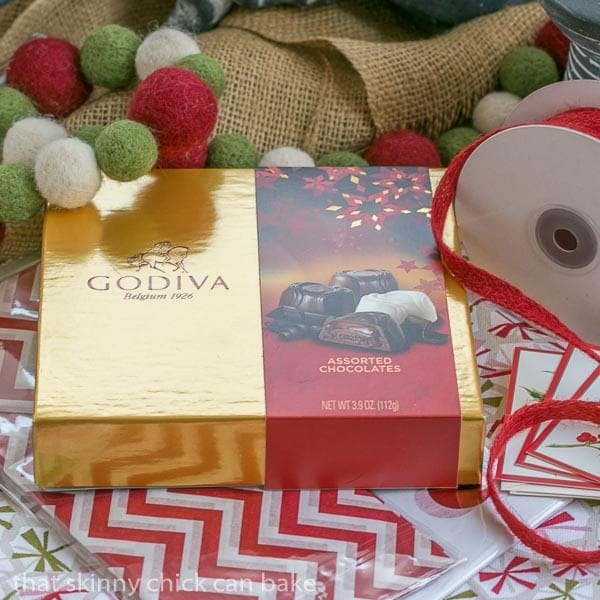 Boxes of GODIVA Chocolates with holiday wrapping paper