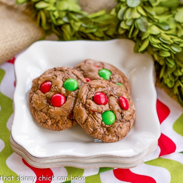Holiday Truffle Cookies with seasonal M&M's on a stack of white plates