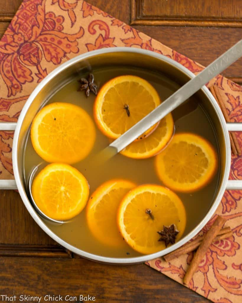 Mulled Apple Cider in a stock pot with orange slices and spices