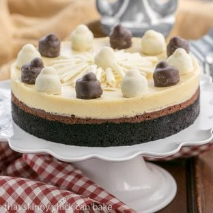 Layered Chocolate Cheesecake | A chocolate cookie crust topped with lusious dark chocolate and Frangelico white chocolate cheesecake - The perfect dessert for a holiday feast!