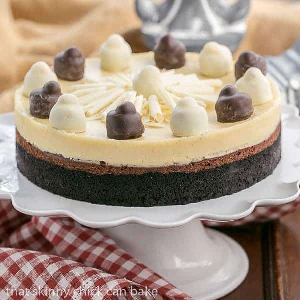 Layered Chocolate Cheesecake   A chocolate cookie crust topped with lusious dark chocolate and Frangelico white chocolate cheesecake @lizzydo
