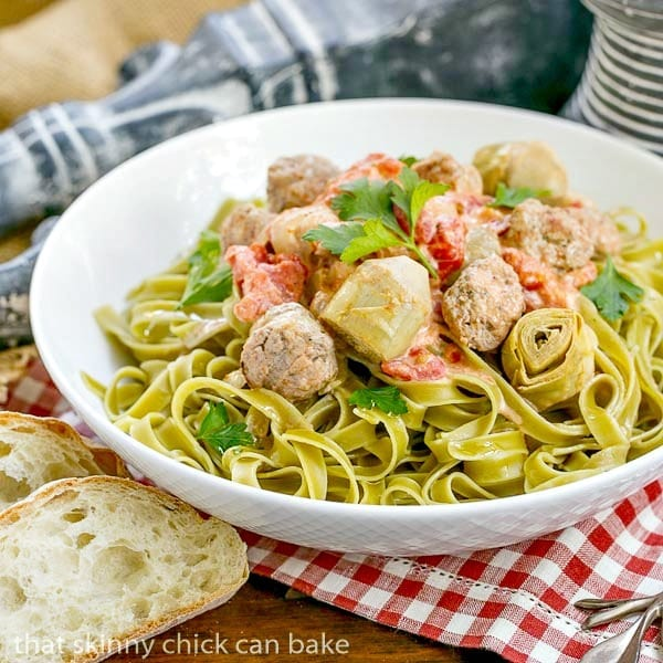 Pasta with Sausage and Cream - Pasta swirled with a creamy sauce, artichoke hearts, tomatoes and Italian sausage. #ad