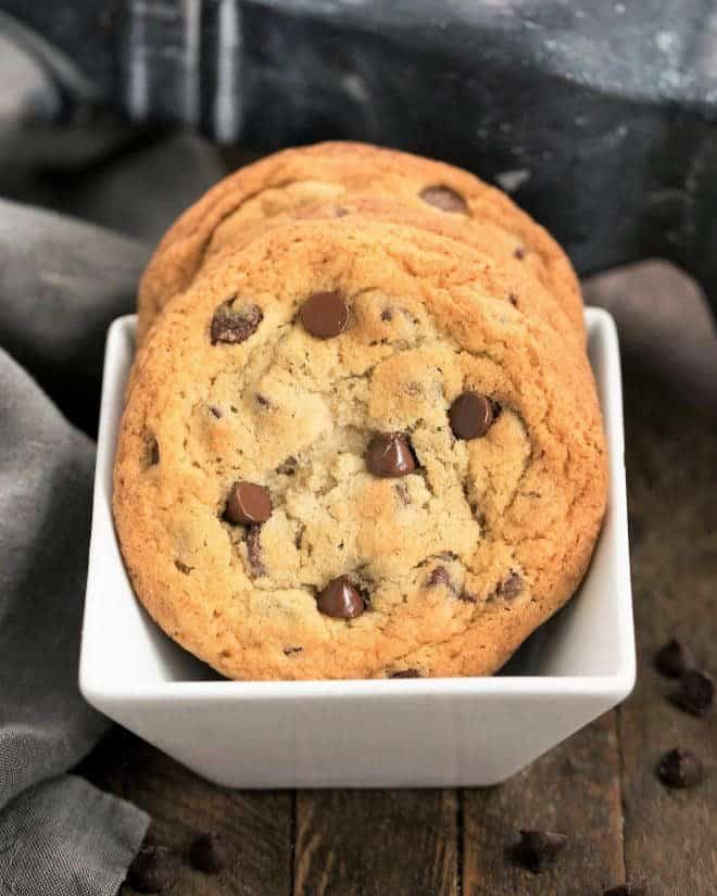 Thin Chewy Chocolate Chip Cookies in a square white bowl
