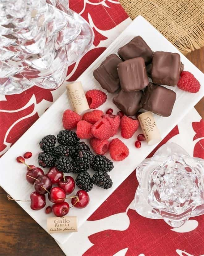 Overhead view of Chocolate Dipped Cheesecake Bites with fruit