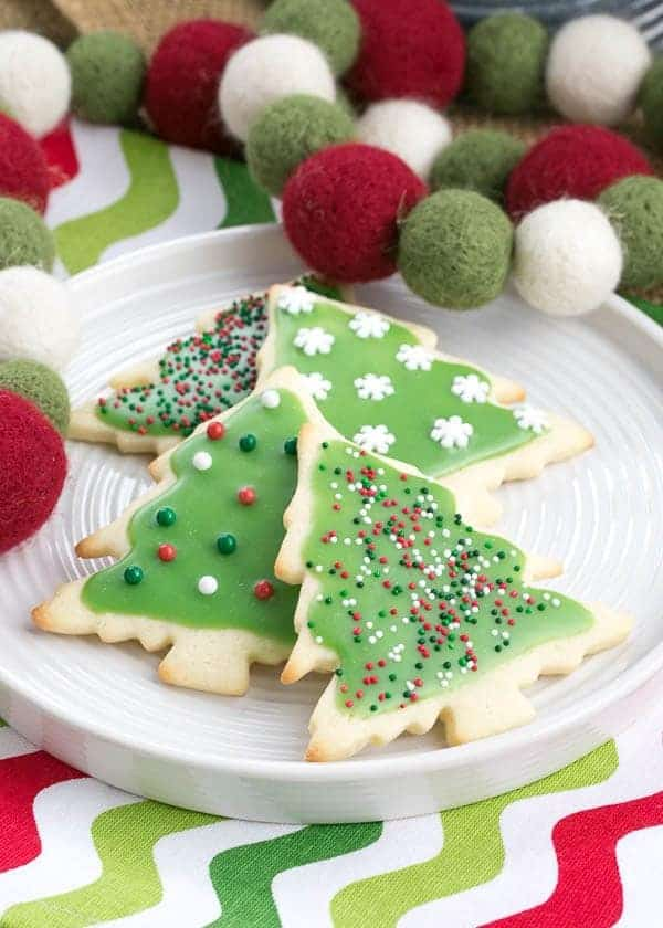 Best Sugar Cookies on a white plate on a Christmas napkin with holiday felt garland
