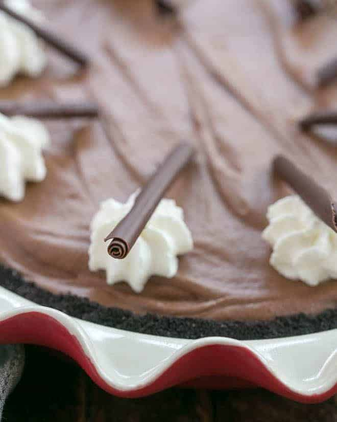 Close up of Frangelico French Silk Pie garnishes of whipped cream and chocolate curls