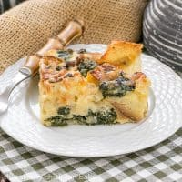Gruyere Spinach Strata | A terrific cheesy breakfast casserole made with bread, French Gruyere and spinach!
