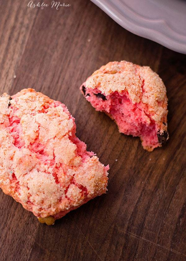 Chocolate Peanut Butter Pink Scones on a wood surface