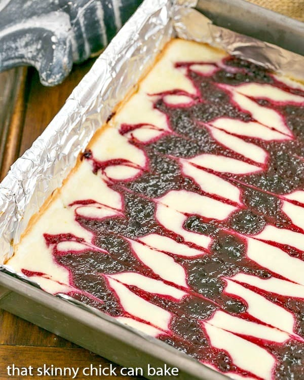 Blackberry Cheesecake Bars |Sublime cheesecake bars with swirls of blackberry jelly
