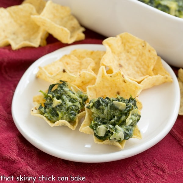 Cheesy Spinach Dip  Spinach, artichoke hearts and lots of cheese will make this the favorite dip at every party!