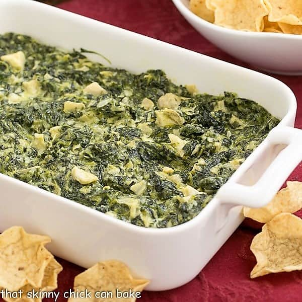 Baked Cheesy Spinach Dip in a white casserole dish