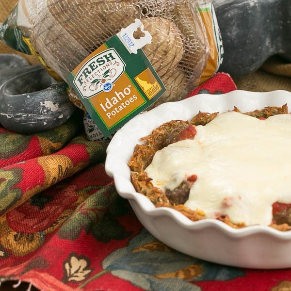 Italian Poutine Pie   A savory pie with a hash brown crust, marinara, meatballs and gooey mozzarella