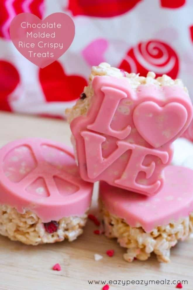 Chocolate Molded Rice Crispy Treats on a cutting board with a Valentine's Day towel