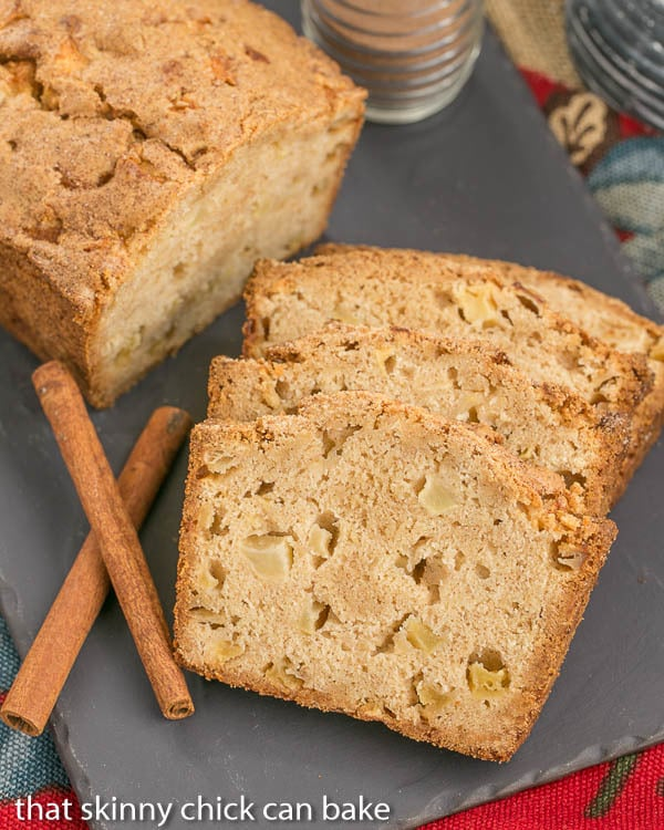 Cinnamon Spiced Apple Bread slices and a partial loaf on a slate tray
