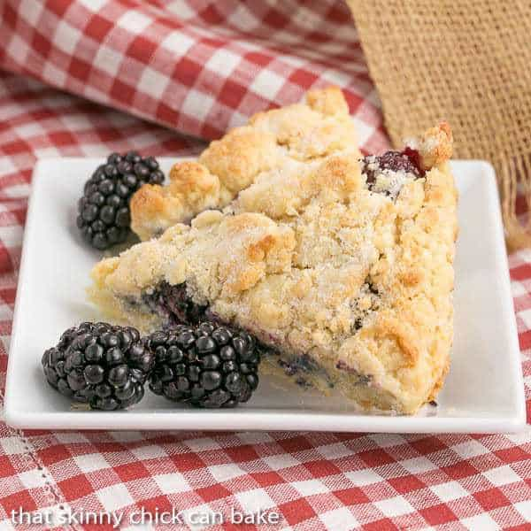 Fresh Blackberry Scones with Cream on a white square plate