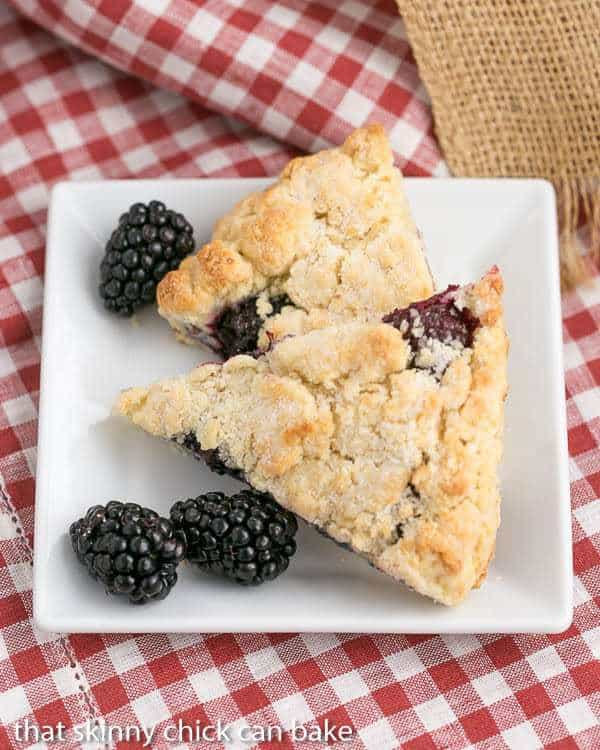 Overhead view Fresh Blackberry Scones with Cream on a white plate
