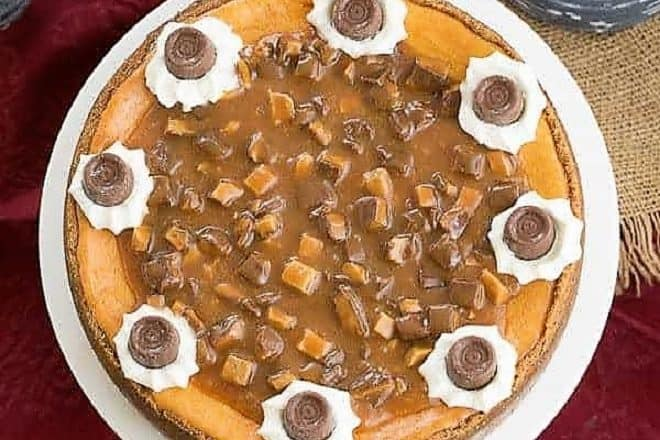 Overhead view of a Caramel Cheesecake on a white cake plate