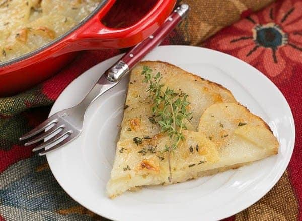 Cheesy Potato Galette - Sliced potatoes with Gruyere, shallots and herbs create a marvelous side dish