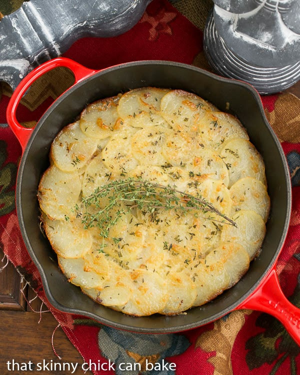 Cheesy Potato Galette | Sliced potatoes with Gruyere, shallots and herbs create a marvelous side dish