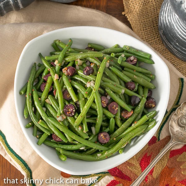 Mustardy Haricots Verts | Green beans tossed in a mustard vinaigrette and topped with Kalamata olives