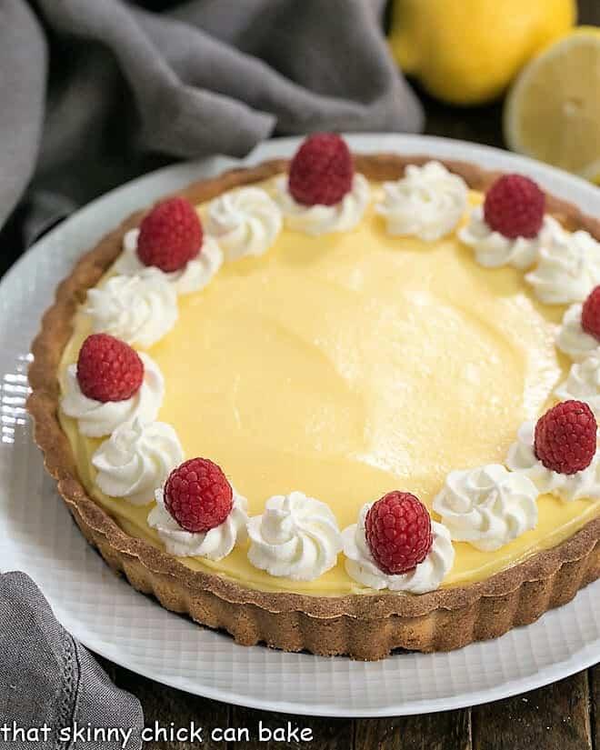 Close view of Creamy Lemon Tart on a white serving dish