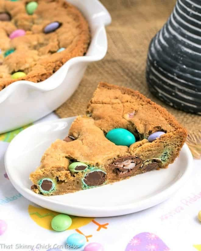 a slice of Easter Cookie Cake made with pastel colored M&Ms