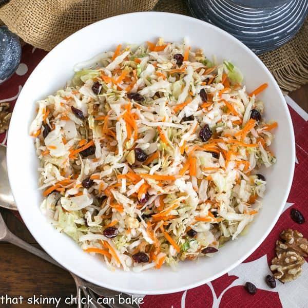 Easy Coleslaw | A simple vinaigrette plus craisins and walnuts makes for a super simple, delicious slaw!