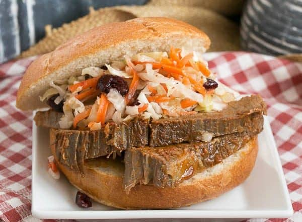 Oven Braised Texas Brisket sandwich topped with coleslaw