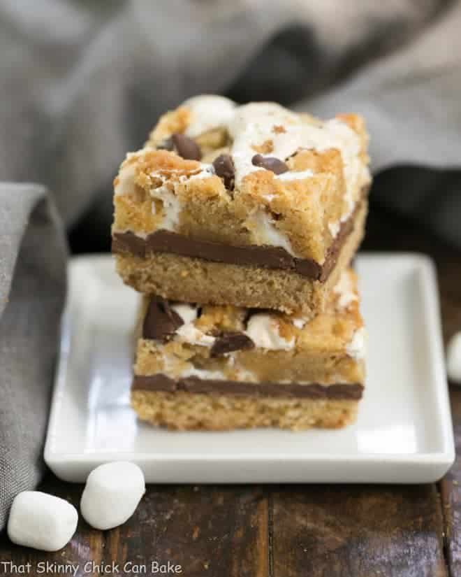 S'mores Cookie Bars stacked on a white plate