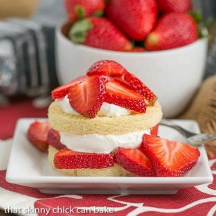 Strawberry Shortcakes with Olive Oil Cake | Tender cake rounds topped with sweetened whip cream and ripe, juicy strawberry slices
