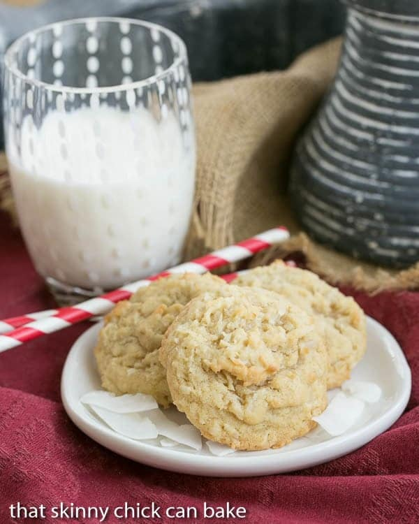Chewy Coconut Cookies on a plate with a glass of milk