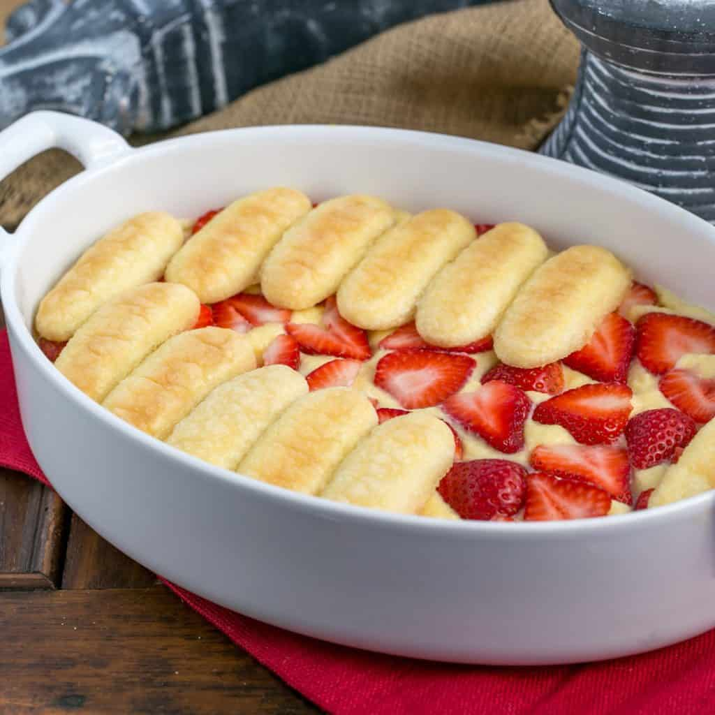Berry Tiramisu with Grand Marnier in a white, oval baking dish