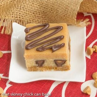 Peanut Butter Cheesecake Bars | Incredibly rich and filled with mini Reese's!