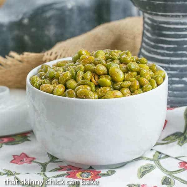 Roasted Creole Edamame in a white bowl