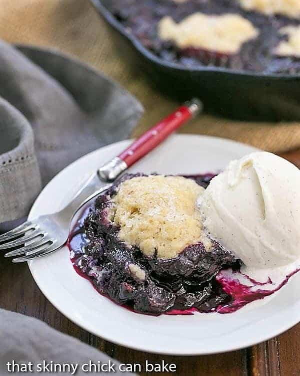 Grilled Blueberry Cobbler a la mode on a white dessert plate