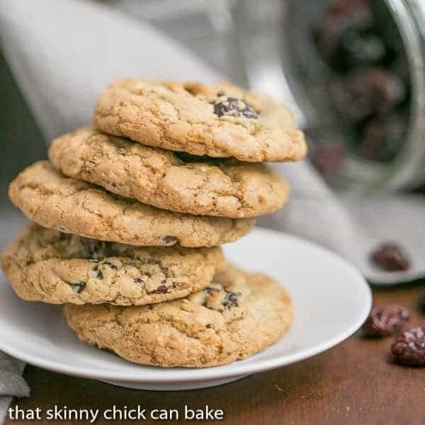 Oatmeal Chocolate Chunk Cookies stacked on a white saucer