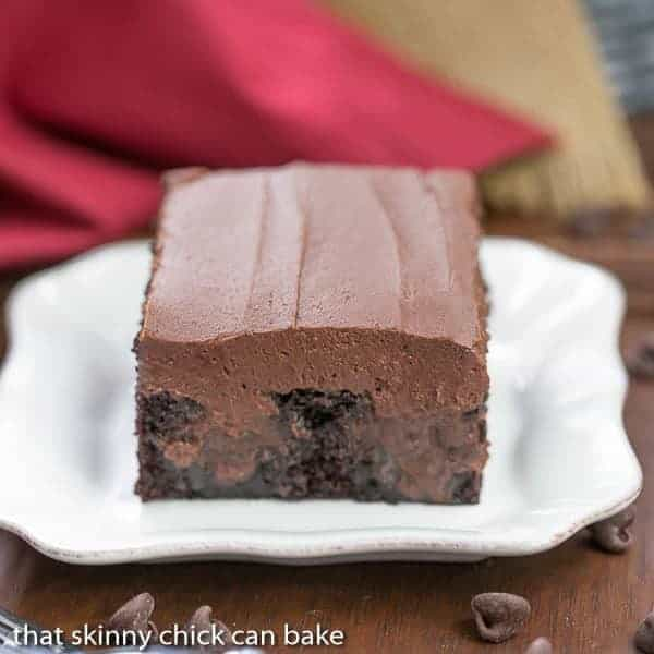 Triple Chocolate Poke Cake | Moist chocolate cake with fudgy filling and chocolate buttercream!