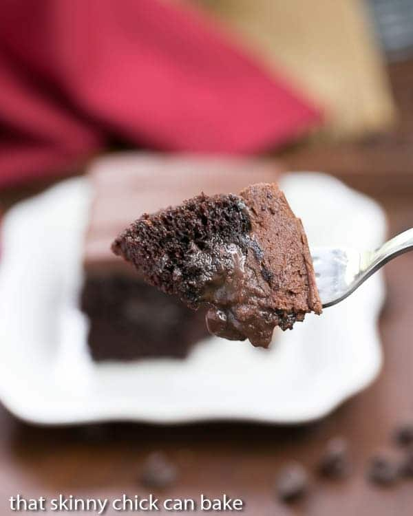 A bite of Triple Chocolate Poke Cake on a fork