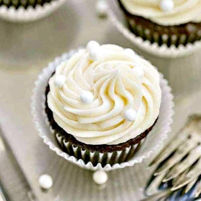 Vanilla Buttercream Topped Cocoa Cupcakes on a silver tray