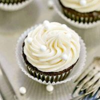 Vanilla Buttercream Topped Cocoa Cupcakes   Moist, scrumptious chocolate cupcakes topped with a mound of vanilla buttercream