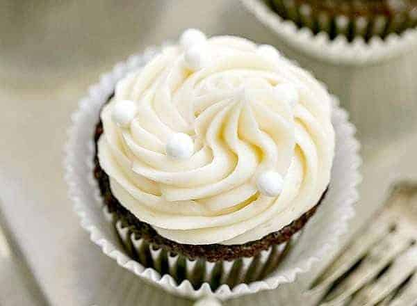 Vanilla Buttercream Topped Cocoa Cupcakes | Moist, scrumptious chocolate cupcakes topped with a mound of vanilla buttercream