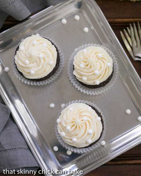 Overhead view of Vanilla Buttercream Topped Cocoa Cupcakes on a silver tray
