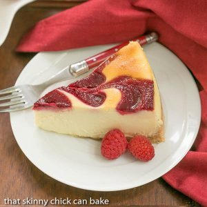 White Chocolate Raspberry Swirl Cheesecake | A luscious White Chocolate Cheesecake with a marbleized raspberry topping