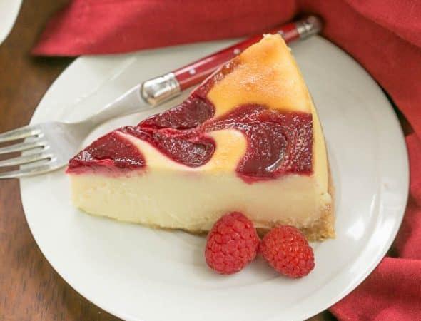 White Chocolate Raspberry Swirl Cheesecake | A luscious White Chocolate Cheesecake with a marbleized raspberry topping