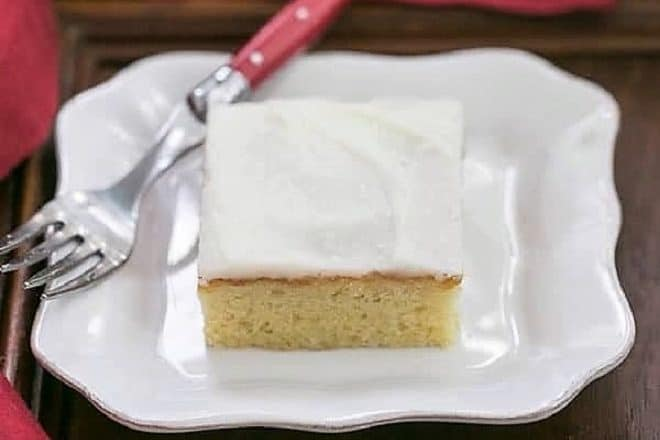 White Sheet Cake - Moist, tender with a touch of almond extract. Perfect when you need to serve a crowd!
