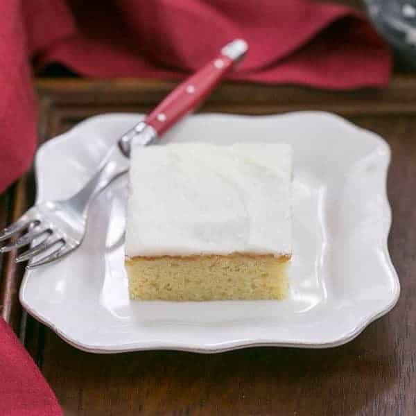 White Sheet Cake slice on white plate